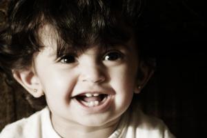 Babies have a language advantage: Cuteness!